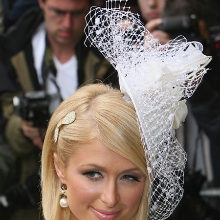 <p>Never the wallflower, Ms Hilton took the trend to the extreme with a Philip Treacy bridal-esque netted fascinator </p>