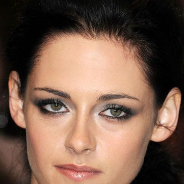 <p>We all want smoky eyes the way Kristen Stewart does them - striking against fresh, radiant skin. The trick to this silver-grey look is to layer up different shades of grey with a much lighter shade in the inner sockets</p>