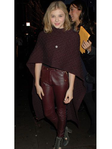 "<p>Maybe it's down to her role as a super-hero in the film Kick Ass, but Chloe Moretz looks very at home in this cool knitted cape. Capes are a fabulous alternative to a classic coat but they can look old-fashioned. The best way to give your cape a modern edge is by doing what Chloe has done here – team it with leather.</p><p></p><a href=""http://www.cosmopolitan.co.uk/fashion/shopping/cosy-cool-winter-fashion-knitwear"">Shop cosy cool winter fashion</a>"