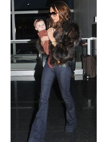 <p>Jeans are an easy staple come winter time, but sometimes they can look <i>too</i> casual when worn warming pieces. Be inspired by Victoria Beckham who glams up her dark winter denim with a luxe faux fur jacket – also managing to make a snug little nest for baby daughter Harper too!</p>