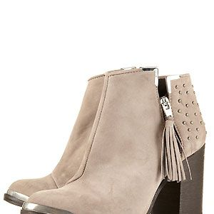 """<p>How utterly divine are these little booties? From the tassel zip to the stacked heel, the metal toe feature to the chic studding. We want these to wear with our skinny jeans now</p><p>£110, <a href=""""http://www.topshop.com/webapp/wcs/stores/servlet/ProductDisplay?beginIndex=0&viewAllFlag=&catalogId=33057&storeId=12556&productId=4286742&langId=-1&sort_field=Relevance&categoryId=277012&parent_categoryId=208491&pageSize=20"""">Topshop</a></p>"""