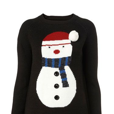 """<p>What could be more festive than this cute snowman jumper? Perfect for cosying up in after your Christmas dinner.</p><p>Jumper, £50, <a href=""""http://www.topshop.com"""">topshop.com</a></p>"""