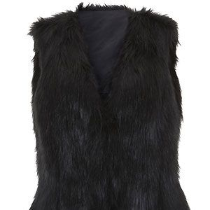 Give faux fur a formal edge by keeping your palette monochrome. Add a pussybow blouse and a sexy leather pencil skirt to your fabulous oversized black shaggy gilet. Purr-fection!