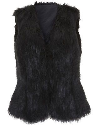 "Give faux fur a formal edge by keeping your palette monochrome. Add a pussybow blouse and a sexy leather pencil skirt to your fabulous oversized black shaggy gilet. Purr-fection! <p>£25, <a href=""http://direct.asda.com/george/clothing/10,default,sc.html"">George at ASDA</a></p>"