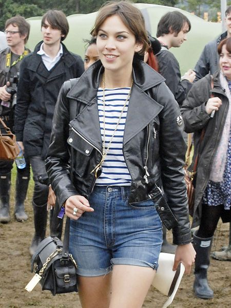 <p>The presenter embodies the trend in her most-wanted Belstaff biker jacket, ensuring she looked uber fashionable in a field</p>