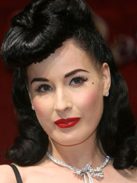 <p>Dita achieves a 1940's flutter with some sexy falsies following her flicks</p>