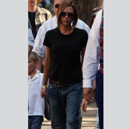 <p>Stop press! Victoria Beckham in baggy jeans, high cut t-shirt <em>and</em> flip-flops? Pinch us, we must be dress-up dreaming</p><p> <br />Image www.splashnewsonline.com  </p>