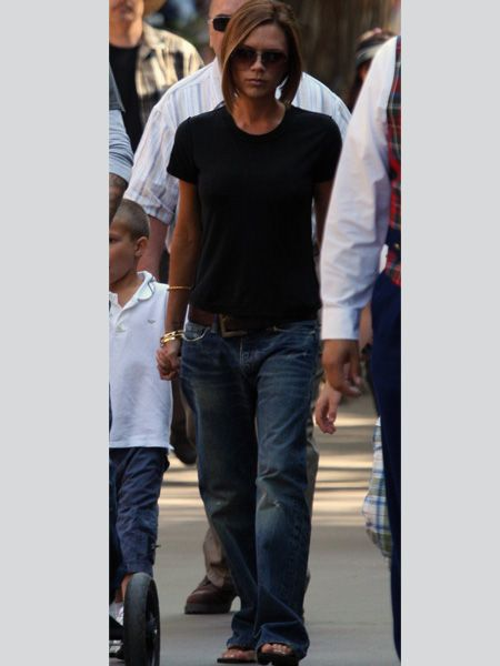 <p>Stop press! Victoria Beckham in baggy jeans, high cut t-shirt <em>and</em> flip-flops? Pinch us, we must be dress-up dreaming</p><p> <br />Image www.splashnewsonline.com  </p>