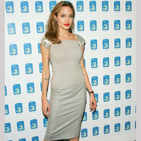 <p>This month's Cosmo cover girl quite literally has it all. The Oscar-winning actress-meets-globetrotting humanitarian super-mum officially has the most envied man and body in the world, and now we're after her wardrobe too. Here are a few reasons why...</p>  <p> </p>