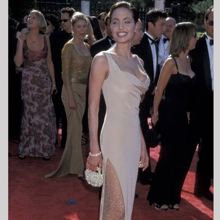 <p>In 1998 she made a big impression on the red carpet showcasing her now world famous décolletage in this satin gold gown</p>