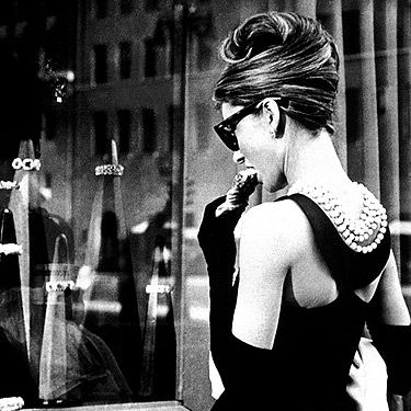 <p>This is about as iconic as films get, and a must-see movie for every gal. From the opening scene where Holly Golightly steps out of a yellow taxi right by Tiffany & Co on Fifth Avenue in NYC (dressed in the now classic Givenchy LBD and pearls combo), right through to the romantic ending, involving lots of rain and the infamous Cat, this is the film that put Audrey Hepburn firmly on the map. Watch the film for classic fashspiration, like the tortoiseshell Ray-Ban sunglasses, the Burberry-esque mac and a lesson in how to truly work a boyfriend shirt (paired with an eye mask, of course).</p>