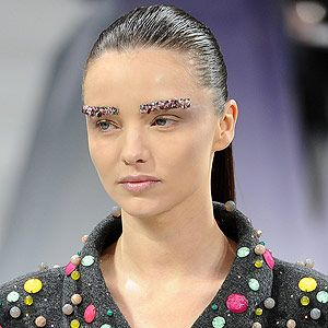 <p>Majestic jewelled brows marked a new era for beauty at Chanel: opulence is going stricter this season. Cobalt blue and emerald green jewels livened up an otherwise flawless and pale complexion.                                                            <br /> </p>