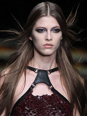 <p>The mood was glam chic with a zest of grunge at Cavalli. The classic smoky eye was revisited with sexy pops of metallic blues, greens, copper and gold to complement a simply tousled middle part.<br /> </p>