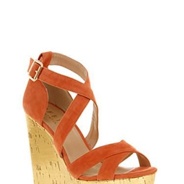 <p>Be the best-dressed cowgirl in town in these cute coral wedges. Yee-ha!</p><p><br />Office, £65</p>