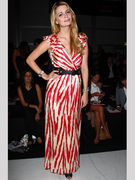 <p>Mischa put in an appearance at Fashion For Relief in a floor length red and cream wrap dress given shape by a waist cinching belt. Does she look chic at fashion week? </p>