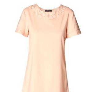 """<p>Beautiful in a candy pink shade, the silhouette of this dress skims problem areas and can be dressed up or down making it the ultimate capsule item. Save space on holiday packing with this gem and combine with different accessories for different occasions.</p><p>£20, <a href=""""http://www.boohoo.com/collections/retro-glamour/icat/retro-glamour/"""" target=""""_blank"""">boohoo.com</a></p>"""