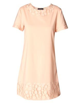 "<p>Beautiful in a candy pink shade, the silhouette of this dress skims problem areas and can be dressed up or down making it the ultimate capsule item. Save space on holiday packing with this gem and combine with different accessories for different occasions.</p> <p>£20, <a href=""http://www.boohoo.com/collections/retro-glamour/icat/retro-glamour/"" target=""_blank"">boohoo.com</a></p>"