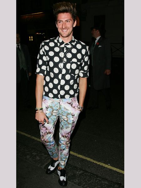 Designer of the moment shows off his eclectic fashion edge with a mismatch of florals and spots - luckily for him, Henry can pull this gear off.  <br />