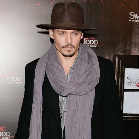 Mr Depp frames those chiselled features with a hat and slouchy scarf - are you tempted?  <br />