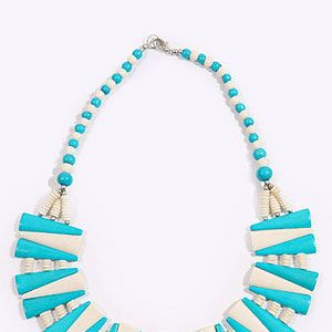 <p>There's a party happening right on your neck! Statement necklaces are SO having a moment, and this bright bib style is spring fresh. It'll add a certain kapow factor to the dullest of outfits.</p>