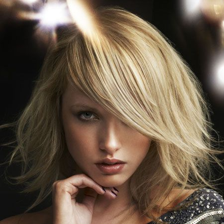 <br />Delicate ice white blonde is broken up with warmer tones of honey gold at the roots and ends for soft, sensuality.<br /><br />Left: Rae Palmer at Rae Palmer Hairdressing, Southsea, Hants, for Schwarzkopf. Tel: 023 9242 6622<br />