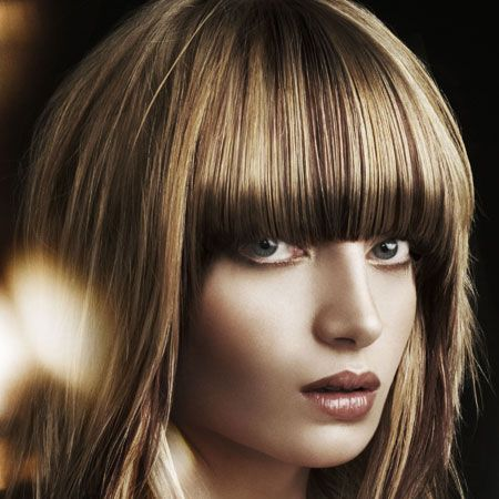 <p> </p><p>Blonde and ruby brown panels of colour create a burnished topaz effect that showcases the shape of the cut perfectly.<br /><br />Left: Rae Palmer at Rae Palmer Hairdressing, Southsea, Hants, for Schwarzkopf. Tel: 023 9242 6622  <br />  </p>