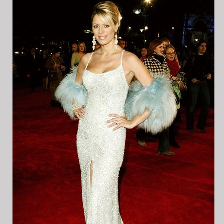 <p>Doing what Tess does best, this glam gown with a blue boa oozed glitz at the premier of Shall We Dance in 2005</p>