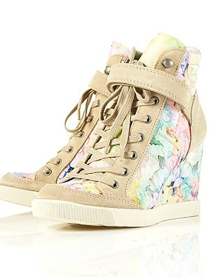 "<p>Think the sports luxe trend is for tomboys only? Think again. These pretty floral hi-tops from Toppers have a concealed wedge so you won't have to forfeit your heels, either. Game ON!<br /><br />Floral wedge trainers, £75, <a title=""http://www.topshop.com/webapp/wcs/stores/servlet/ProductDisplay?beginIndex=0&viewAllFlag=&catalogId=33057&storeId=12556&productId=5469797&langId=-1&sort_field=Relevance&categoryId=277012&parent_categoryId=208491&pageSize=200"" href=""http://www.topshop.com/webapp/wcs/stores/servlet/ProductDisplay?beginIndex=0&viewAllFlag=&catalogId=33057&storeId=12556&productId=5469797&langId=-1&sort_field=Relevance&categoryId=277012&parent_categoryId=208491&pageSize=200"" target=""_blank"">Topshop</a></p>"