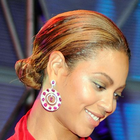 <br />The pop princess showed off her gorgeous features with a slick-back, low slung knot<br /><br />