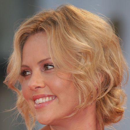 <br />The actress tied her tousled tresses into a loose knot at the base of her head achieving a soft but sexy style<br />