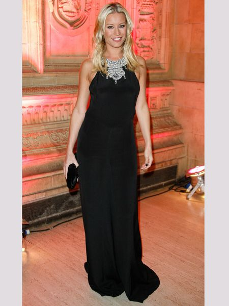 Denise went for an on-trend gothic inspired look with this trailing floaty black gown, sexed-up with an embellished neck line. Do you love her new look or should she stick to showing off her pins?  <br />
