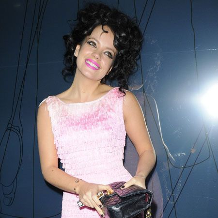 We barely recognised Lily Allen in this pink cocktail dress with matching fuchsia pink lips and a head full of curly hair! The singer smiled sweetly for the cameras (which also made her look different!) as she attended the GQ bash at St Albans in Regent Street, London.  <br />