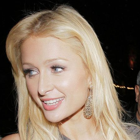 Paris Hilton put on a brave face as she went out for dinner with sister Nicky at Mr Chow in LA, shortly after announcing her split with Benji Madden. There's nothing like sister solidarity...<br />