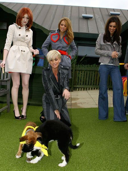 Kind hearted Girls Aloud spent time cuddling up to some lucky canines at the launch of the Dogs Trust charity and its partnership with Nintendo at Highway Farm in Uxbridge. Sarah Harding became particularly attached to one cute pooch and couldn't put the puppy down. We wonder if she smuggled it home in her handbag...  <br />
