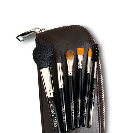 """For touch-ups and travelling, this bag of baby brushes will suit the beauty guru's every need and take her from meetings to martinis in a fabulous flash. Inside the pint-sized pouch is a cheek colour brush, secret camouflage brush, angled and corner eye brushes that will create a flawless look. <br /><br />Available from <a target=""""_blank"""" href=""""http://www.spacenk.co.uk """">www.spacenk.co.uk </a><br /><br />"""