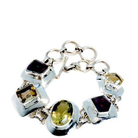 """Get the style-savvy something that sparkles with this bling-tastic sterling silver bracelet. The handmade piece combines colourful Citrine and Amethyst with Lemon Quartz, all encased in silver. Available at <a target=""""_blank"""" href=""""http://www.colouredrocks.com/"""">www.colouredrocks.com  </a><br />"""