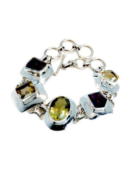 "Get the style-savvy something that sparkles with this bling-tastic sterling silver bracelet. The handmade piece combines colourful Citrine and Amethyst with Lemon Quartz, all encased in silver. Available at <a target=""_blank"" href=""http://www.colouredrocks.com/"">www.colouredrocks.com  </a><br />"