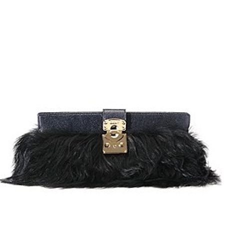 """Fabrics with fringing and feathers will be on every fashionista's wish list, so treat her to this long-haired faux fur clutch and she'll be in accessory heaven. The clutch from <a target=""""_blank"""" href=""""http://www.harrods.com"""">www.harrods.com</a> is finished with a glossy patent leather and golden clasp - perfect for parading with a knockout dress.  <br />"""