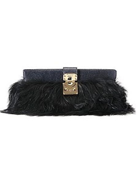 "Fabrics with fringing and feathers will be on every fashionista's wish list, so treat her to this long-haired faux fur clutch and she'll be in accessory heaven. The clutch from <a target=""_blank"" href=""http://www.harrods.com"">www.harrods.com</a> is finished with a glossy patent leather and golden clasp - perfect for parading with a knockout dress.  <br />"