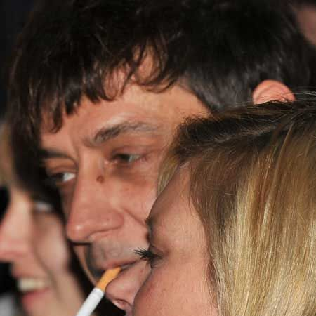 Kate Moss and Jamie Hince were sporting matching cuts and bruises on their faces as they helped turn on the Christmas lights at the Stella McCartney boutique in Chelsea. They couple were keen to hide their minor wounds from the paparazzi (Jamie had one impressive black eye) and buried their faces in one another's arms as an unfazed Stella looked on...  <br />