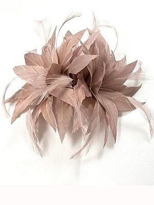 """<p>For the Grandstand at Ascot, fascinators make the grade. This clip-in feathered version will top off your nude ensemble to perfection.<br /><br />Kaliko spike clip fascinator, was £30, now £21, <a title=""""http://www.houseoffraser.co.uk/Kaliko+Spike+clip+fascinator/168164063,default,pd.html"""" href=""""http://www.houseoffraser.co.uk/Kaliko+Spike+clip+fascinator/168164063,default,pd.html"""" target=""""_blank"""">House of Fraser</a></p>"""