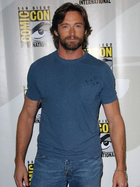 Oozing masculinity in this casual combo of blue top and rugged locks, Hugh channels his inner Wolverine who he played in the X-Men movie in 2000. If only he'd rescue us!  <br />
