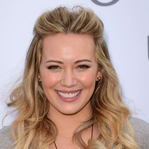 <p>Curls don't have to be wham, bam, gorgeous and glam, we like them nice and natural too and you can't go wrong with Hilary Duff's flowing curls. Quiffing your hair at the front and smoothing it back means there's no need to deal with roots and is great for disguising grease too while the rest of her hair has been loosely tongued to create a summer finish that you could easily eek out for two days.</p><p><strong>Top Tip:</strong> If you're curling your hair with a tong, only rough dry your hair otherwise it will be too smooth and won't hold as well</p>