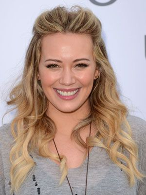 <p>Curls don't have to be wham, bam, gorgeous and glam, we like them nice and natural too and you can't go wrong with Hilary Duff's flowing curls. Quiffing your hair at the front and smoothing it back means there's no need to deal with roots and is great for disguising grease too while the rest of her hair has been loosely tongued to create a summer finish that you could easily eek out for two days.</p> <p><strong>Top Tip:</strong> If you're curling your hair with a tong, only rough dry your hair otherwise it will be too smooth and won't hold as well</p>