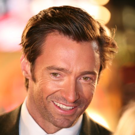Hugh knows how to work the crowd as he flirts with the fans and flashes them a smile. We'd wait in the freezing temperatures just to be close...  <br />