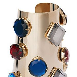 <p>No one will want to mess with you wearing this bejewelled armour cuff.  Make like Xena Warrior Princess and wear your blinged-up armour with pride.</p>