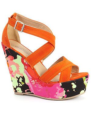 "<p>The higher the better where shoes are concerned and these colourful wedges are just what we need to stand out from the crowd in Ibiza!</p> <p>Floral print heel wedges, £24.99, <a href=""http://www.newlook.com/shop/shoe-gallery/view-all-shoes/bright-orange-floral-print-heel-wedges_246242782"">New Look</a></p>"