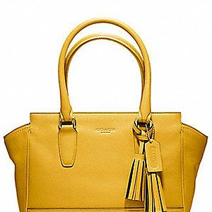 """<p>Add a bit of sunshine with Natalie Joos' monochromatic inspirations in the new COACH 'Legacy' collection. Forget the umbrella and yellow out!</p><p>Legacy Leather Candace Carryall, £295, <a title=""""http://www.coach.com/online/handbags/genWCM-10551-10051-en-/Coach_US/StaticPage/sunflower?LOC=LN#113095"""" href=""""http://www.coach.com/online/handbags/genWCM-10551-10051-en-/Coach_US/StaticPage/sunflower?LOC=LN#113095"""" target=""""_blank"""">Coach</a></p>"""