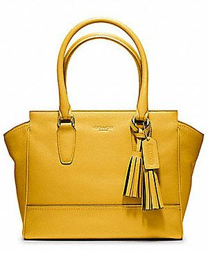 "<p>Add a bit of sunshine with Natalie Joos' monochromatic inspirations in the new COACH 'Legacy' collection. Forget the umbrella and yellow out!</p> <p>Legacy Leather Candace Carryall, £295, <a title=""http://www.coach.com/online/handbags/genWCM-10551-10051-en-/Coach_US/StaticPage/sunflower?LOC=LN#113095"" href=""http://www.coach.com/online/handbags/genWCM-10551-10051-en-/Coach_US/StaticPage/sunflower?LOC=LN#113095"" target=""_blank"">Coach</a></p>"