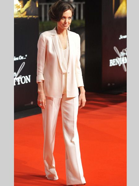 Ange joined Brad on the red carpet for the premier of The Curious Case of Benjamin Button wearing a tailored cream creation. Do you love her power suit or does she have more impact in a glamorous gown?  <br />
